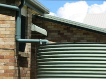 Urban Water Tank. Photo of suburban house with water tank storage, suitable for articles concerning sustainability, environment, drought, water restrictions etc Stock Images