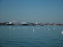Urban waterfront. View of an urban waterfront across the harbor royalty free stock photography