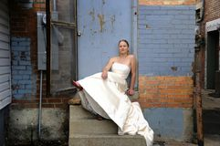 Urban wedding girl. Woman on steps in a wedding dress Royalty Free Stock Image