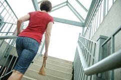 Urban Woman. Walking up stairs stock photography