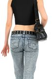 Urban woman in jeans, with handbag Royalty Free Stock Photo