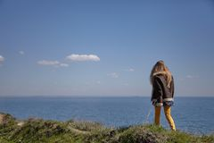 Girl walks above the sea royalty free stock photos