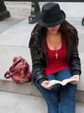Urban Woman Reading in City Stock Image