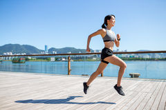 Urban woman running in Hong Kong Royalty Free Stock Image
