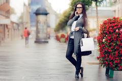 Urban  Woman With Shopping Bags Outside Royalty Free Stock Images