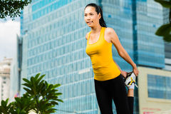 Urban woman sports - fitness in Asian city Royalty Free Stock Photography