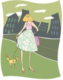 Urban Woman Walking Her Funny Cat. Freehand drawing of a stylized woman walking her funny cat on a leash in the city Royalty Free Stock Image
