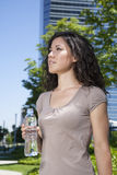 Urban woman with water bottle Stock Images