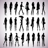 Urban women silhouettes. Set of female silhouettes in the city on abstract background Stock Photo