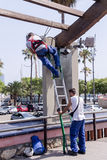 Urban workers spend repair work near the Olympic port Stock Photo