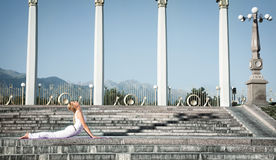 Urban Yoga bhujangasana cobra pose Royalty Free Stock Photo