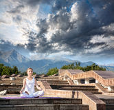Urban Yoga meditation at mountains Stock Photo