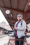 Young man with glasses and beard waiting the train Stock Images