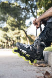 Urban young man on roller skates on the road Stock Images