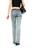 Urban young woman in jeans Stock Image