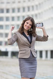 Urban young woman showing positive emotion Stock Photos