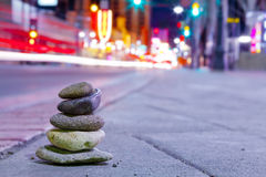 Urban Zen. Zen Rock Pile in Urban City Scene Stock Photo