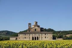 Urbania Marches, Italy: old farm. Urbania Montefeltro, Pesaro Urbino, Marches, Italy. Historic farm and field of sunflowers Royalty Free Stock Photo