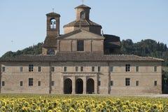 Urbania Marches, Italy: old farm. Urbania Montefeltro, Pesaro Urbino, Marches, Italy. Historic farm and field of sunflowers Royalty Free Stock Photography