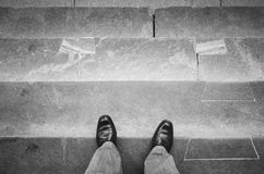 Urbanite man in black shoes on stone stairs Royalty Free Stock Photo