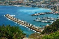 Urbanization of coastal city. Harbor Stock Photo