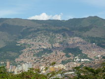 Urbanization in the mountains Medellin, Colombia. Process of deforestation and urbanization on mountains, example of Medellin in Colombia Stock Photos