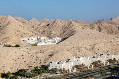 Urbanization in Muscat, Oman. Small urbanization in the mountains near Muscat, Sultanate of Oman, Middle East Royalty Free Stock Images