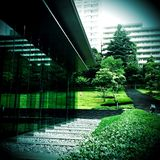 An urbanscape, Mita, Tokyo. A relaxed space in a busy business area in Stock Image