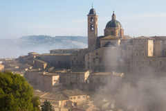 Urbino city lost in the fog on early morning Royalty Free Stock Photography