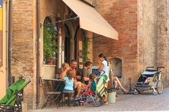 Urbino, Italy - August 9, 2017: the family has had a snack at the ice cream parlor. Urbino, Italy - August 9, 2017: the family has had a snack at the ice cream Stock Photo
