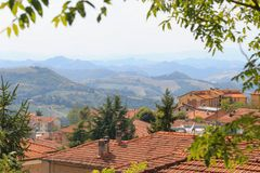 Urbino, Italy - August 9, 2017: the old city. roofs of houses under red tiles. view from above. Stock Photos