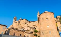 Urbino skyline with Ducal Palace, Italy. Urbino, Italy - August 13, 2015: view of skyline with Ducal Palace in Urbino, Italy. The historic center of Urbino was stock photography