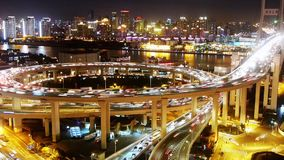 Urbn heavy traffic jam on highway interchange at night,urban cityscape. Aerial freeway busy city rush hour heavy traffic jam highway Shanghai at night,timelapse stock video footage