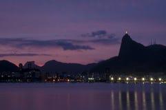 Urca`s sunset. Corcovado and Botafogo Beach - Rio de Janeiro, Brazil Royalty Free Stock Photos