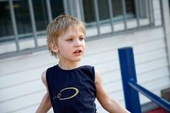 Urchin. Little boy alone on the street Stock Photo