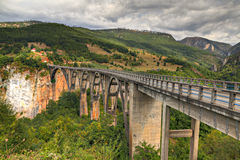 �urdevica arched Tara Bridge,. �urdevica arched Tara Bridge over green Tara Canyon. One of the world deepest Canyons and UNESCO World Heritage, Montenegro Royalty Free Stock Photo