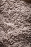 Urgammal smutsig skrynklig pappers- vertikal version Arkivfoto