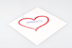 Urgent. Heart drawn in lipstick on a white background stock images
