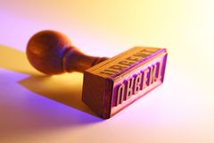Urgent. Lying rubber stamp, showing the word urgent royalty free stock photo