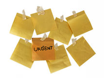 Urgent. Note urgent on yellow paper stock images