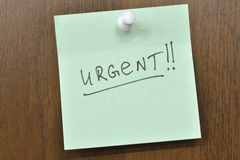Urgent. Post it note with urgent! word royalty free stock photography