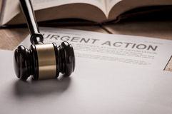 Urgent Action. With gavel. Class action concept stock photo