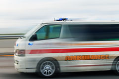 Urgent ambulance moving fast to rescue life Royalty Free Stock Photography