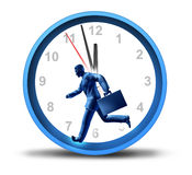 Urgent Business Deadlines. Urgent business deadline with a man in a suit and briefcase running in a clock with minute and hour hands ticking away as a symbol of Stock Images