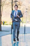 Urgent businessman runs in the city Royalty Free Stock Photos