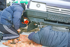 Urgent car repair. Tambov, Russia - February 21, 2015: Winter car track races on the Cup of the Tambov region. Urgent repairs suspension of the right wheel of Royalty Free Stock Images