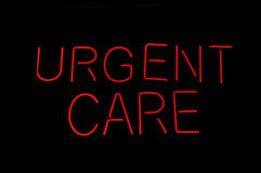 Urgent Care Medical Sign. Medical Red Urgent Care Neon Sign against black royalty free stock images