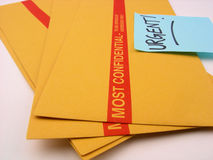 Urgent and Confidential Business. Most Confidential envelopes that need to be taken care of in an urgent manner... very important Royalty Free Stock Photos