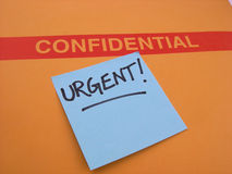 Urgent and Confidential Business. A Confidential envelope that needs to be taken care of in an urgent manner... very important royalty free stock photos