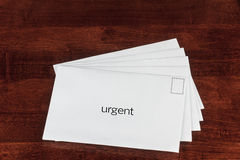 Urgent. Delivery Concept with Letters in White Envelope Stock Photos